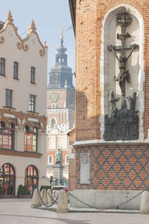 tenement: Poland, Krakow, Marienplatz Square, the wall of St Marys church, tenement tenement Czyncielw, Mickiewicz statue, town hall tower in the background