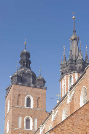 vierge marie: Poland, Krakow, market square, st Mary Mariacki church towers and southern wall, sunlit, midday