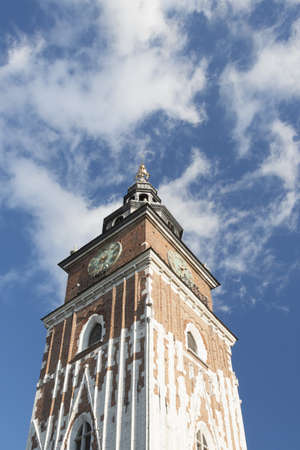 main market: Poland, Krakow, Main Market, Town Hall tower, sunlit, blue sky, white clouds