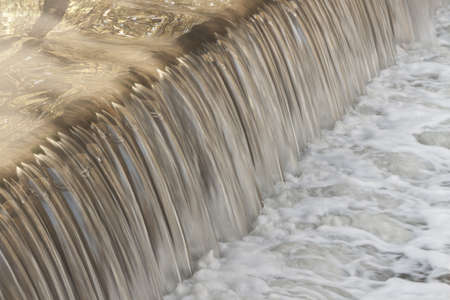 polluted: Polluted water or sewage falling, forming foam