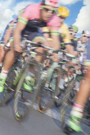 exploit: Participants cycling race, motion blur, zoom in, the sky in the background Stock Photo