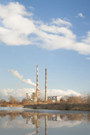 thermal pollution: Cogeneration heat and power CHP plant in Krakow, Poland, sunlit, clouds on blue sky, autumn