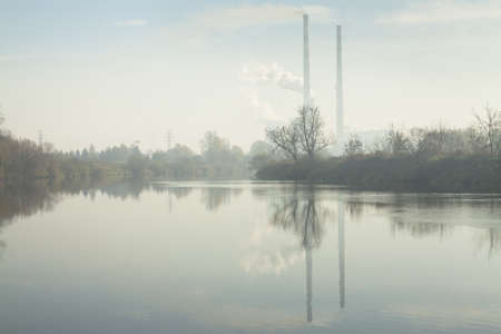 Poland, Krakow, Cogeneration Plant CHP seen through the smog Stok Fotoğraf
