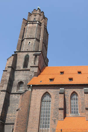 silesia: Poland, Silesia, Gliwice,All Saints church tower and nave seen from east, sunlit