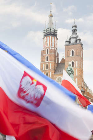 rynek: Poland, Krakow, Polish Flags foreground, Towers of St Mary Church background, demonstration