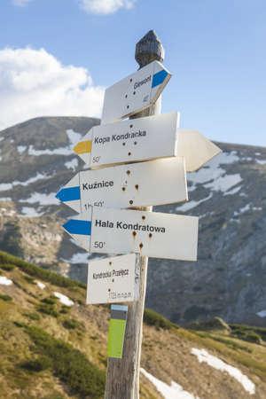Poland, Tatra mountains, Signpost at Kondracka Prze??cz, reamins of snow