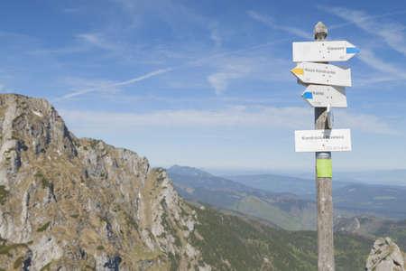 Poland, Tatra mountains, Signpost at Kondracka Prze??cz, overcast sky