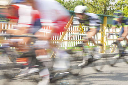 Group of cyclist during a race on a bridge, motion blur