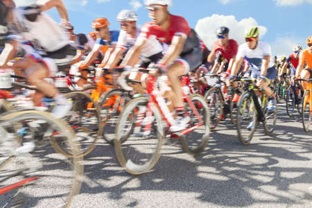 Group of cyclist during a race, sunlit, motion blur