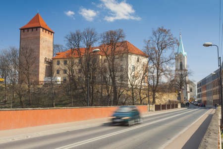 Poland, Malopolska, Oswiecim, Piast Castle early spring, sunlit, cars in motion