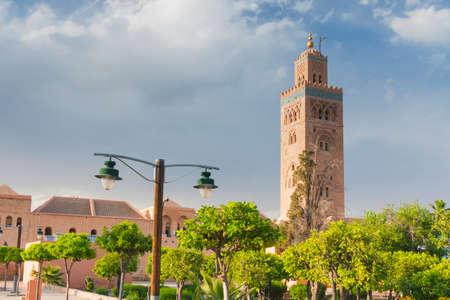 Koutubia Mosque minaret in Marrakech, Morocco, sunlit, blue sky, seen from Koutubia gardens