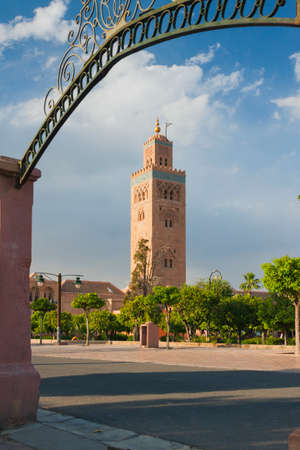 Koutubia Mosque minaret in Marrakech, Morocco, sunlit, blue sky, seen from Koutubia gardens
