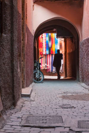 Archway and Alley in Medina Area, Marakech, Morocco, traditional scarves on the wall