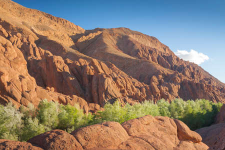 Monkey Fingers Cliffs in Morocco, Dades Gorge, sunlit with spectacular lighting effects
