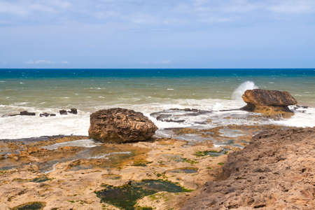 Rocky shore of the Atlantic Ocean in Essaouira, Morocco, sunlit