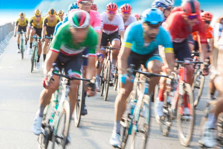 Group of Cyclist During a Race, motion blur, blue sky Stock Photo - 129908363