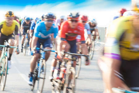 Group of Cyclist During a Race, motion blur, blue sky Stock Photo - 129908365