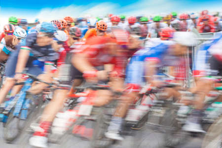 Group of Cyclist During a Race, motion blur, blue sky