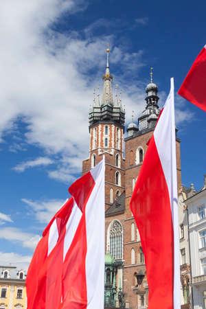 Flags of Poland, Krakow, Main Market, Virgin Mary Church, sunlit