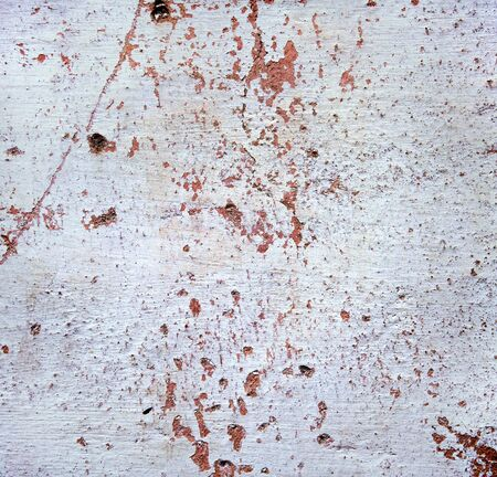 Grunge texture . Red stains , scratches and dots on white background . Wall surface .