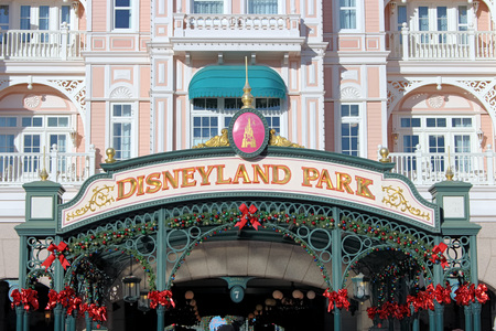 blind child: FRANCE - NOVEMBER 22, 2015: Disneyland amusement park entrance in Paris, France. Disneyland is the first entertainment group in the world in 2012.