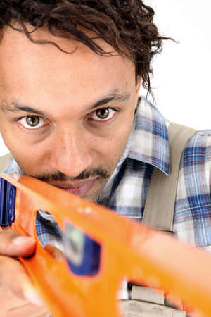 Carpenter using a laser level Stock Photo - 10047463