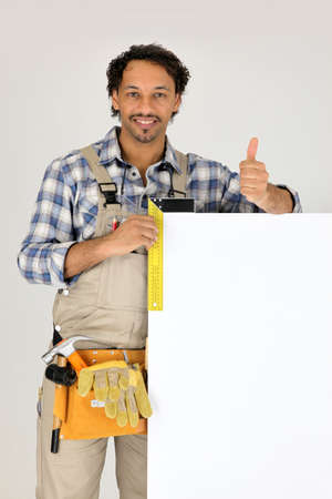 Builder stood with blank advertising panel Stock Photo - 10213032