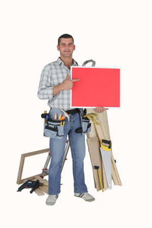 Mr. Fixit pointing to a red sign Stock Photo - 10548761