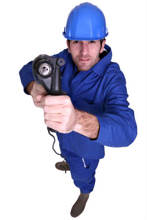 high angle shot blue collar using drill Stock Photo - 10658121