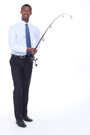 american banker: Man in a shirt and tie using a fishing rod Stock Photo
