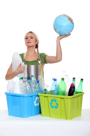 international recycle symbol: Woman recycling and holding planet earth in her hands Stock Photo