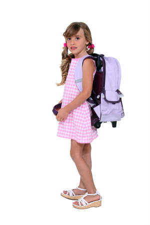 colegiala: Niña con su mochila Foto de archivo