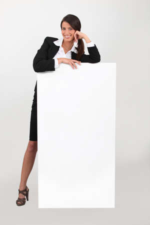 publicity: Business woman with blank poster Stock Photo
