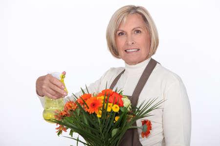 senior florist preparing a bouquet Stock Photo - 10746807