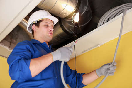 wire: Electrician repairing ceiling wiring