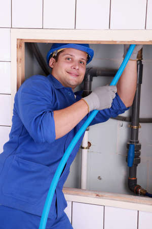 Plumber fixing some pipes Stock Photo - 10740135