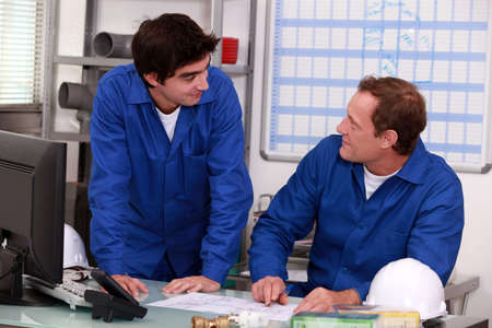 journeyman: Plumbers in an office Stock Photo