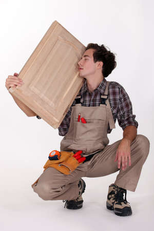 carpenter holding a wooden window Stock Photo - 10740175