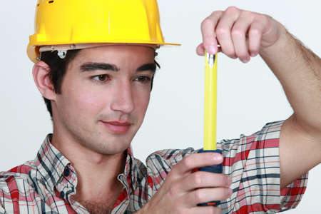 Builder holding tape measure Stock Photo - 10747273
