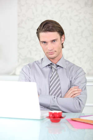 insurer: Insurer sitting at his a desk Stock Photo