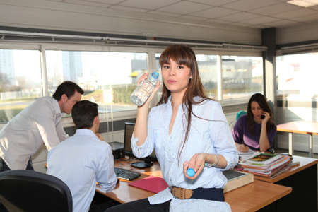Woman having break in office Stock Photo - 10747259