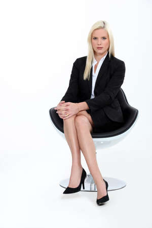 Studio shot of a blonde businesswoman in a suit photo