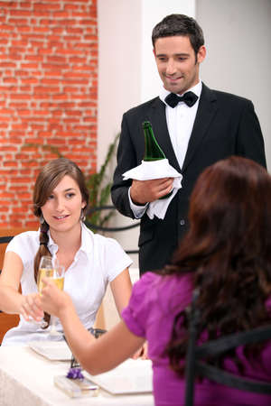 Women drinking champagne in a restaurant photo