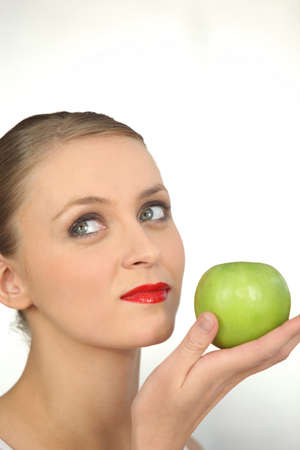 Woman in red lipstick holding a green apple Stock Photo - 10746748