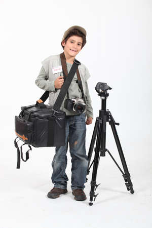 Little boy dressed as news camera man Stock Photo