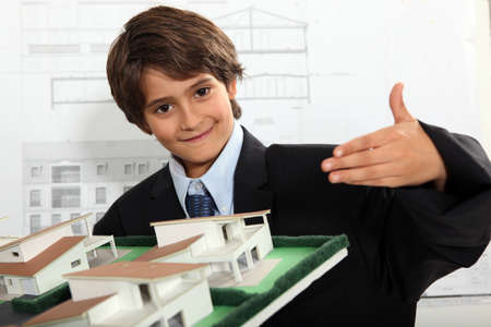 Boy dressed as a businessman in an architect Stock Photo - 10746765