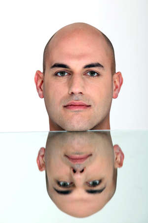 Reflection of bald man Stock Photo