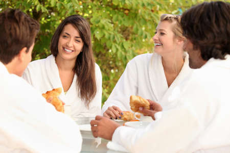 Four friends sharing breakfast Stock Photo - 10746789