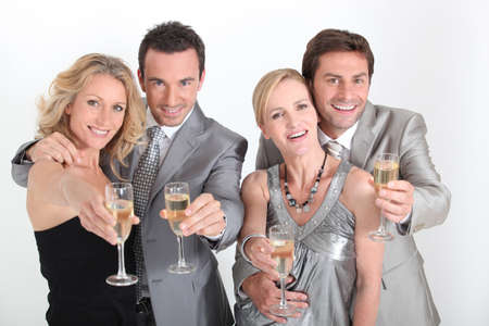 Four people celebrating with champagne. Stock Photo - 10747377