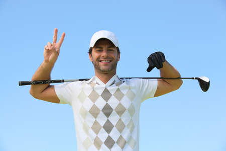 35 39 years: Happy golfer giving peace sign